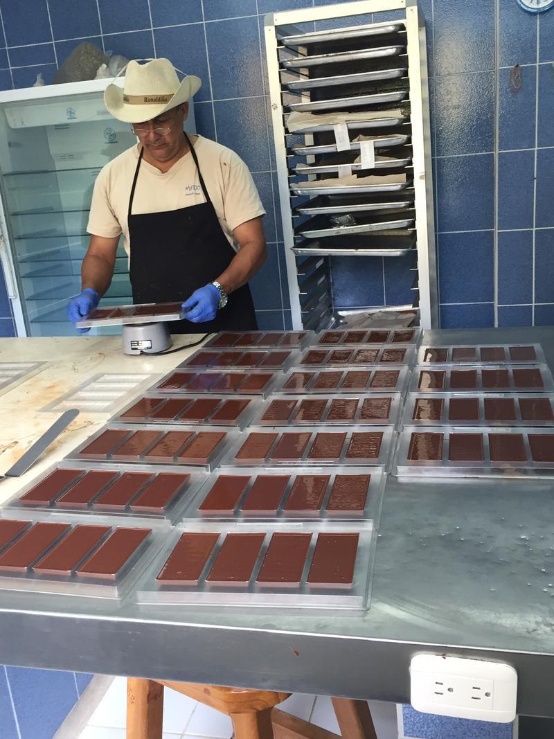 An employee making chocolate in Mindo Ecuador.