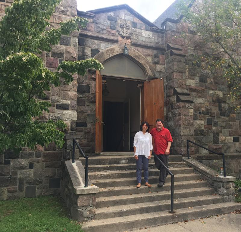 Yen Azzaro and Steve Pierce on the steps of the Congregational church being transformed into a community performance space.