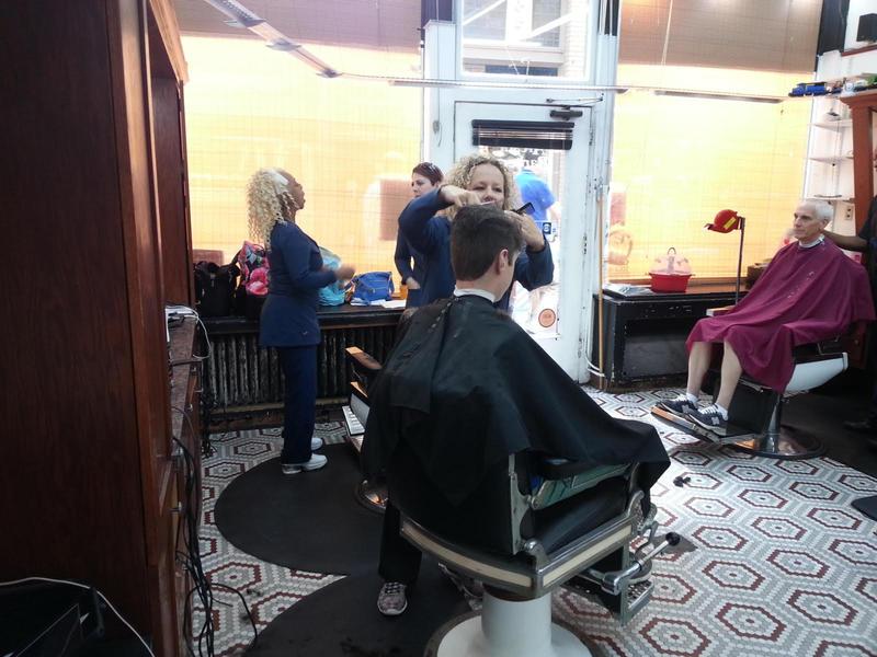 Tiffany Royal giving a haircut