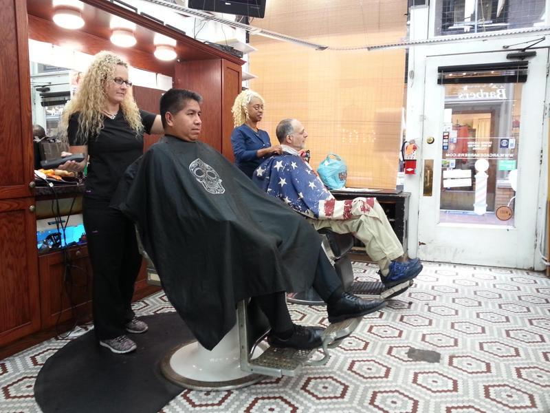Tiffany Royal and Tina Masterson giving  haircuts