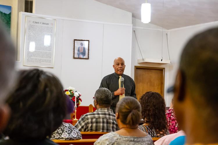 Nat Alston addresses the crowd at the Walking While Black: L.O.V.E. is the Answer screening on July 26 at New Testament Baptist Church in Ypsi.