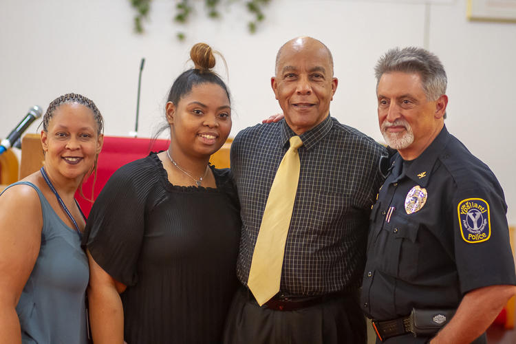 Leah Mills, Erin Mills, Nat Alston, and Tony DeGiusti pose for a photo after the Walking While Black: L.O.V.E. is the Answer screening on July 26 at New Testament Baptist Church in Ypsi.