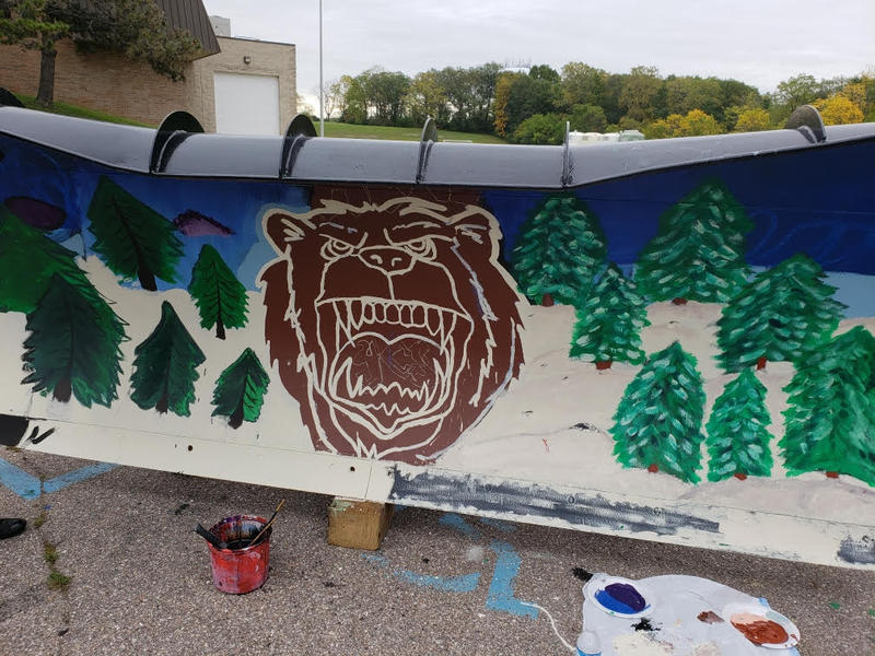 Ypsilanti Community High School's mascot, a grizzly bear, was painted on the plow.