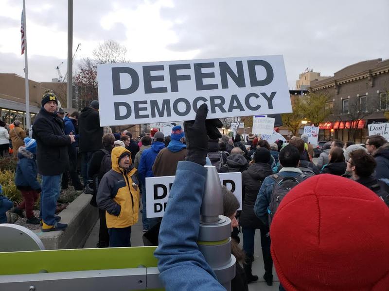 Defend Democracy sign.