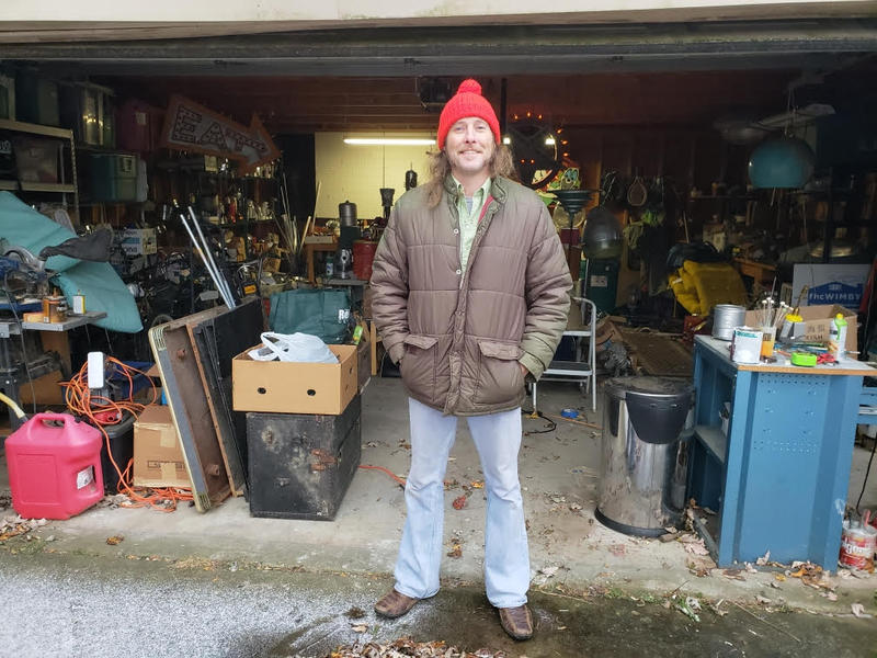 Artist Cre Fuller outside of his garage in Ypsilanti.