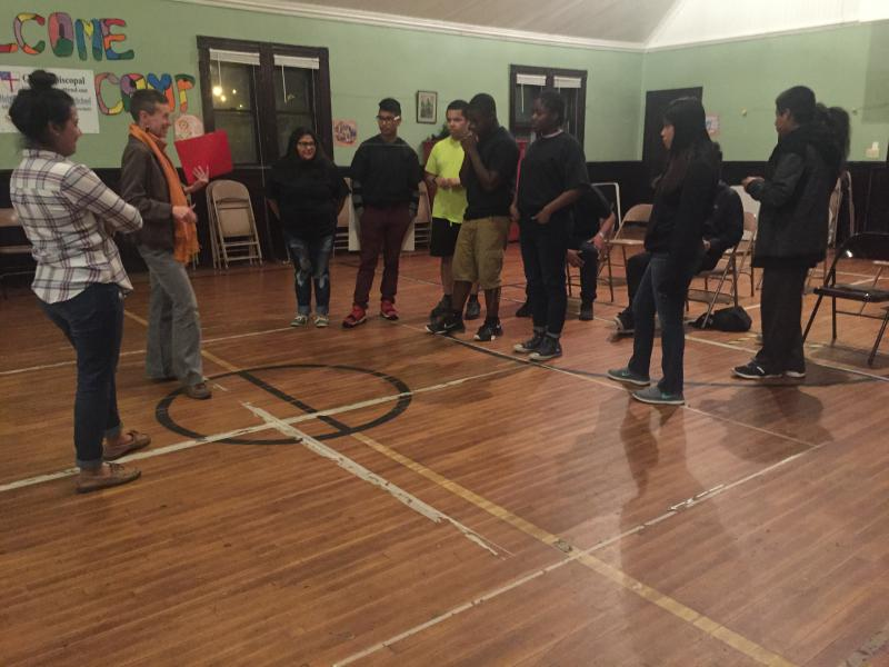 Justice Organization of Youth (JOY) members rehearse for their upcoming performance