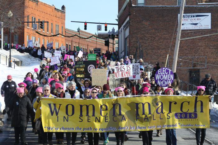 Participants in the Women's March in the streets of Seneca Falls