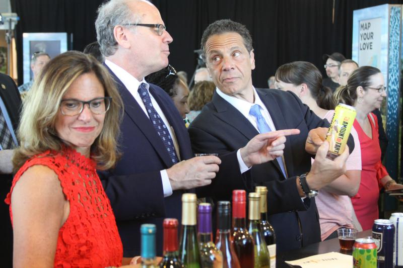 Ginny Carter of New York Kitchen, Empire State Development's Howard Zemsky, and Governor Andrew Cuomo at the opening of the new Finger Lakes Welcome Center.