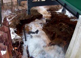 A water main break rages under the South Millvale Bridge in Bloomfield in January.