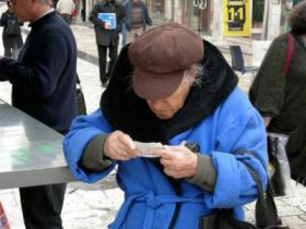 This unidentified man looks over his lottery ticket to see if he is due a prize.