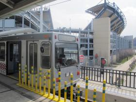 """A Port Authority """"T"""" train pulls up to a stop near Heinz Field, one of the premier rail destinations of the North Shore Connector."""