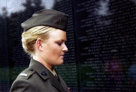 """Lieutenant Elle Helmer in front of the Vietnam War Memorial, from """"The Invisible War"""""""