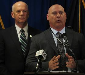 Supervisory Special Agent Michael Christman speaks to reporters on Thursday, releasing details of a drug ring bust in Homewood. United States Attorney David Hickton is also pictured.