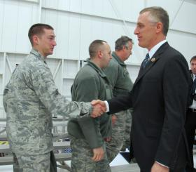 Representative Tim Murphy talks with service members at 911th Airlift Wing.