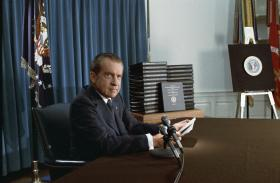President Nixon with edited transcripts of White House tape conversations during a broadcast of his address to the Nation in 1974.