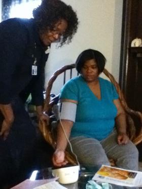 Dorretta Lemon checks Sarah Murphy's blood pressure at her Wilkinsburg home.