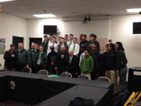 Dan Rooney meeting with teens from Pittsburgh and Northern Ireland in the Press Room of Heinz Field