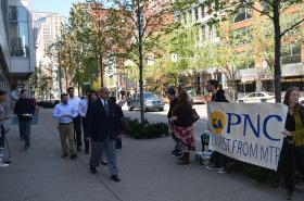 Because the Earth Quaker Action Team was protesting PNC's shareholder meeting, security workers escorted attendees in and out of the August Wilson Center, where the meeting was held