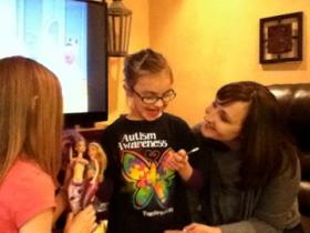 Emma, 11 (left) and Lily, 7, play with their mother Leslie Walter at their home in Shaler. Lily has autism, and according to Leslie,  her daughter would be in a completely different place without the dedicated assistance of a behavior specialist. Leslie worries about what could happen with an interruption of services.