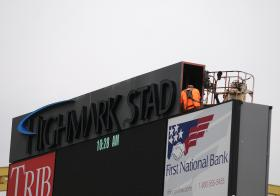 A worker installs a portion of a Highmark Stadium sign Thursday. Construction on the $10.2 million stadium began in July 2012 and wrapped up this month.