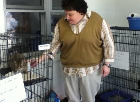 Jamie Cochran, Vocational Supervisor at Caritas House, pictured with one of the cats at the facility.
