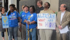 Community members and environmental groups gather in Downtown Pittsburgh to call for more transparency from ALCOSAN as they study incorporating green components in its wet weather plan.