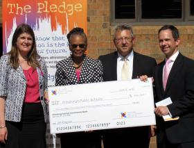 Pittsburgh Brashear Co-Principal Kimberly Safron, Pittsburgh Public Schools Superintendent Linda Lane and NMSI's Dale Fleury accept a grant from the Heinz Endowments.