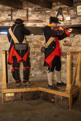 French and Indian War re-enactors point their weapons through the oak gun loops that tests show are in great shape after 249 year of exposure to the weather.