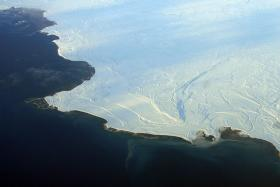 Sea ice, shown here in Nunavut, in northern Canada, reflects more sunshine than in the past, while and open ocean absorbs more, accelerating melting.