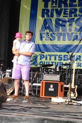 WYEP Morning Mix co-host, Joey Spehar on stage at the 3 Rivers Arts Festival with his daughter.