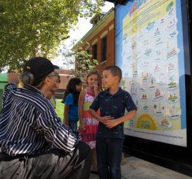 Children engaging with the WordPlay activities posted on city bus shelters.