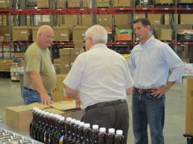State Rep. Dave Reed speaks with volunteers at the Greater Pittsburgh Community Food Bank
