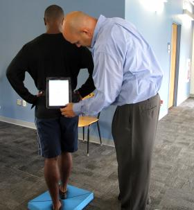 Allegheny Health Network's Craig Castor demonstrates the C3 Logix system on an athlete. The program tests for concussion symptoms.