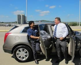Raj Rajkumar and U.S. Rep. Bill Shuster emerge from the self-driving Cadillac SRX after being driven to the airport from Cranberry Township.