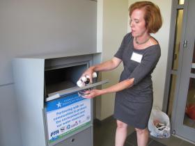 Josephine Posti, Mt. Lebanon School Director and spokesperson for Pennsylvania American Water, drops prescription drugs in the new drop box at the Mt. Lebanon Public Safety Center