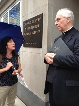 Frances Samber of the Survivors Network of those Abused by Priests talks with Pittsburgh Catholic Diocese spokesman the Rev. Ron Lengwin about adding names of priests accused of sexual misconduct on the diocesan website.