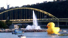 The Rubber Duck Project passes by Point State Park in Pittsburgh Friday afternoon.
