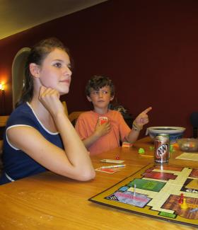 Haley and Ian Zuroski of Squirrel Hill listen as their mom makes a guess during a family game of Clue.