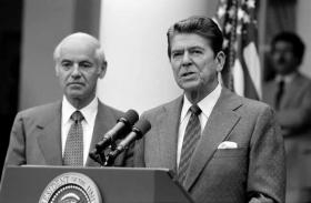 President Reagan with William French Smith making a statement to the press regarding the air traffic controllers strike (PATCO) from the Rose Garden.