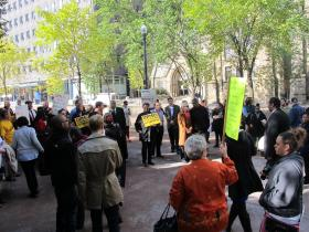 Protesters gather outside UPMC in downtown Pittsburgh