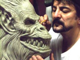 """Tom Savini sculpting """"Fluffy,"""" one of the grotesque monsters from the 1982 film Creepshow."""
