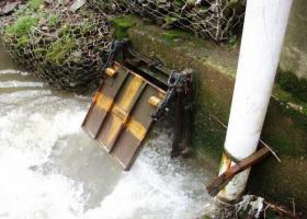 Raw sewage and rainwater overflow into Chartiers Creek.