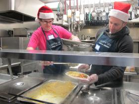 Joseph Papalia, 16 (left) helps his uncle Joseph Conforti serve food at Light of Life Rescue Mission on the North Side.