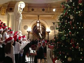 The state Capitol Christmas trees have been lit, one inside, and another outside the Capitol building.