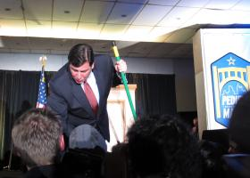 """Bill Peduto is congratulated by supporters during his election night victory.  He's holding a broom because he wants to make a """"clean sweep"""" of city government."""