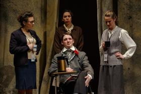 Teachers assess Paul, portrayed by Daniel Curran, in the Pittsburgh Opera production of Paul's Case.