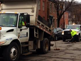 Public Works employees filling potholes on the South Side. Open Data could give citizens real time info about hazardous streets and when they'll be fixed.