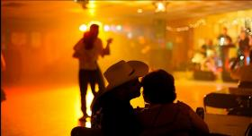 Patrons enjoy each other's company at Cowboy's Dancehall in San Antonio, Texas.