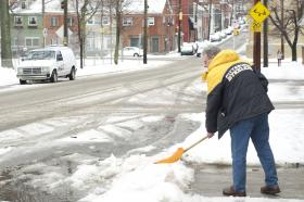 A Southside resident digs out from Tuesday's storm, which brought several inches of snow and ice to the region.