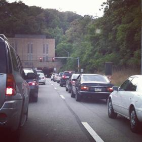 Traffic is stopped at a red light approaching the Squirrel Hill Tunnel.
